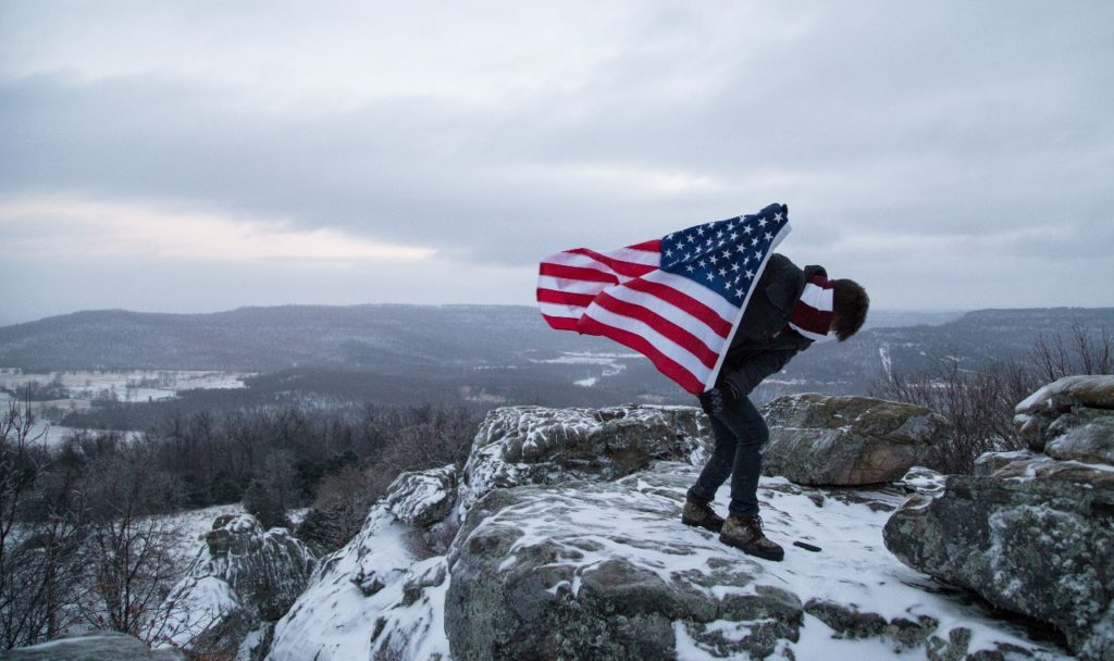 american-flag-guy-on-mountain-1280x760