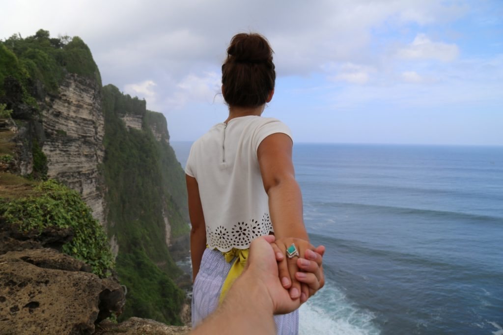 woman-by-cliff-holding-mans-hands (1280x853)