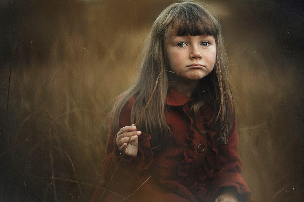 Girl-sad-in-field (1280x853)