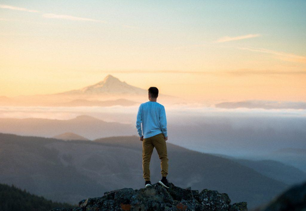 man-on-mountain-overlooking-mountains (1280x881)