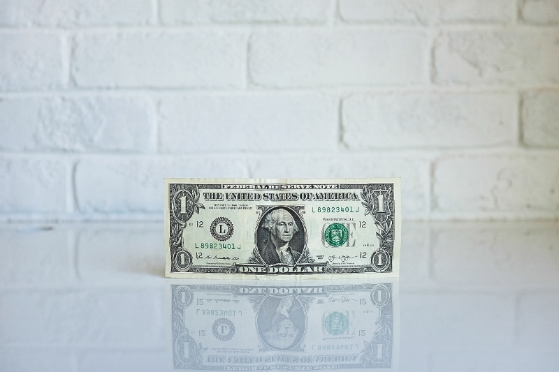 Money-dollar-bill-white-wall (800x533)